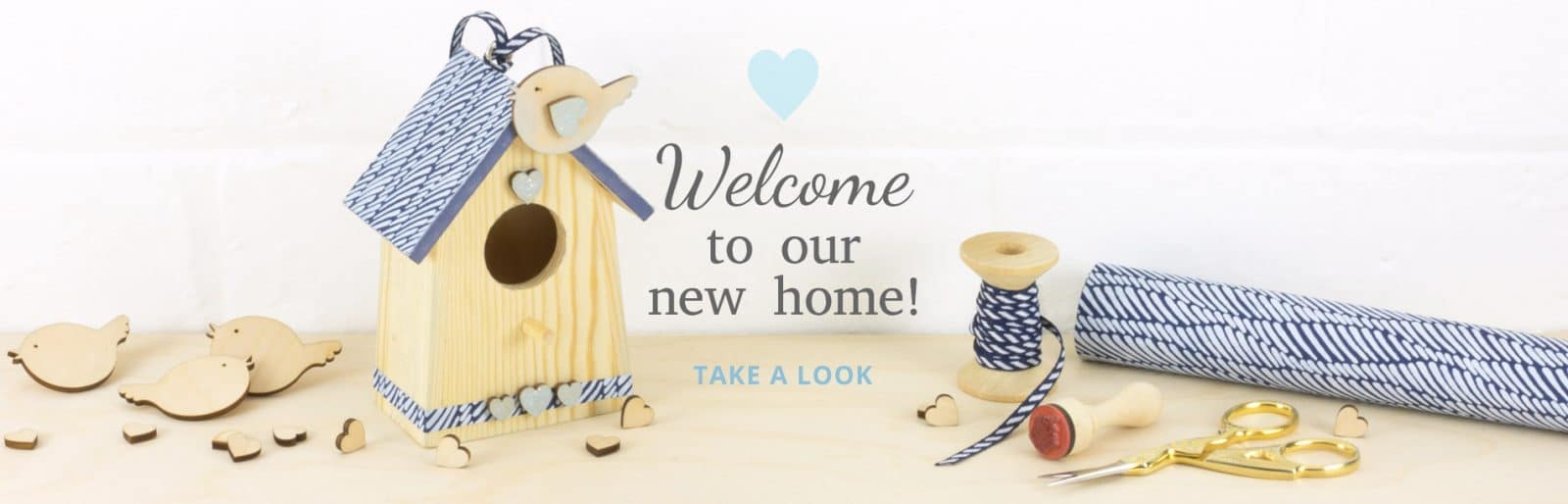 New Home Banner with wooden shapes
