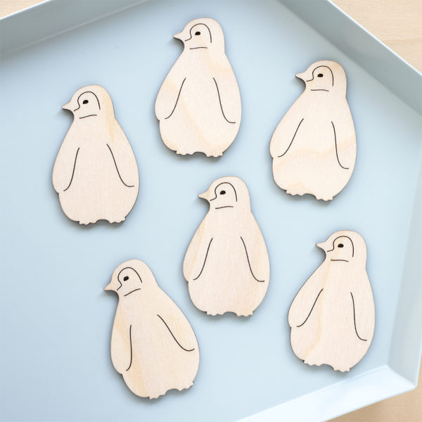 Wooden baby penguins